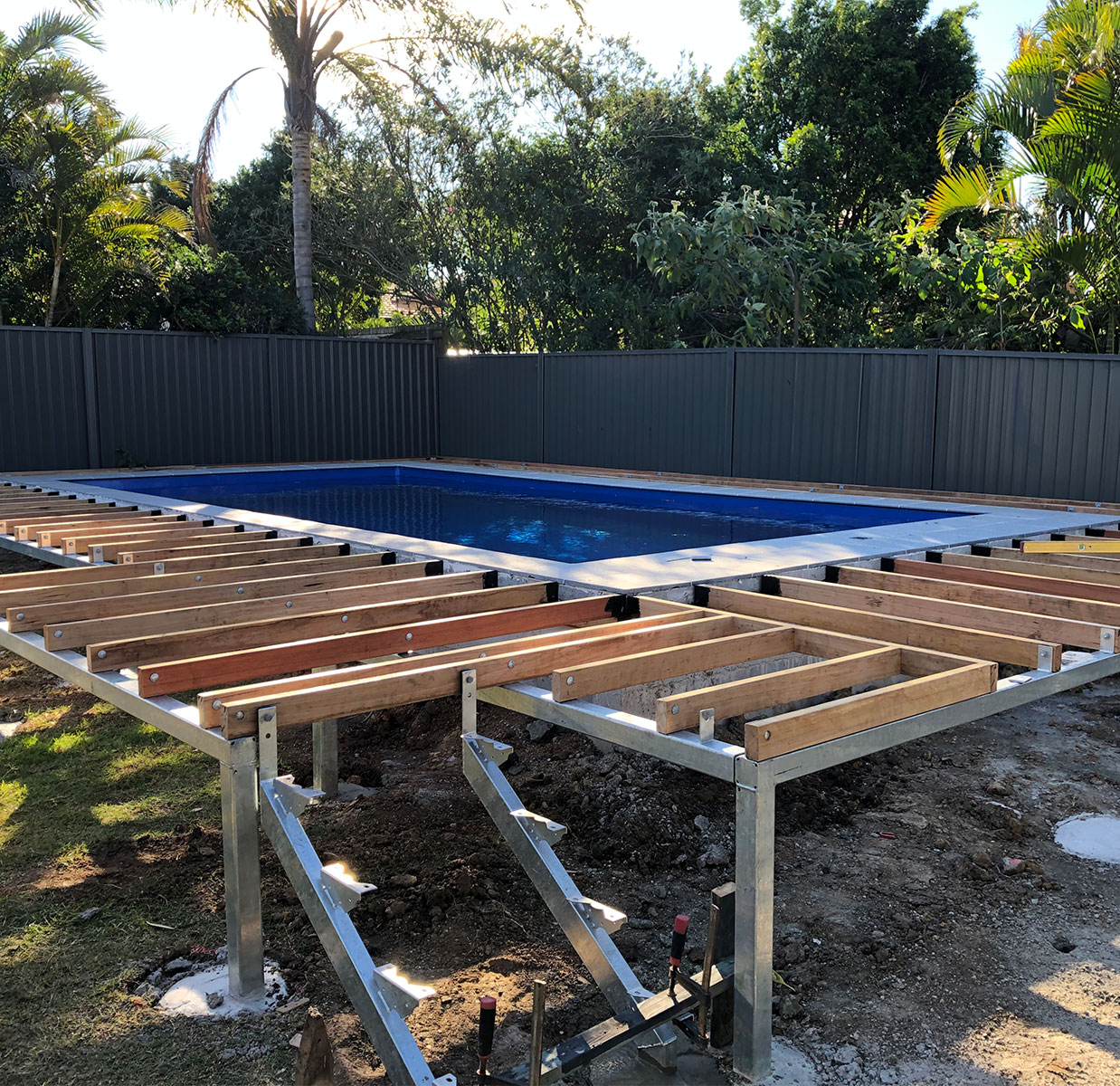 Pool decking construction